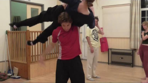 Jane Connelly (flying) and Ross Atkins (base/underdancer perform a lift